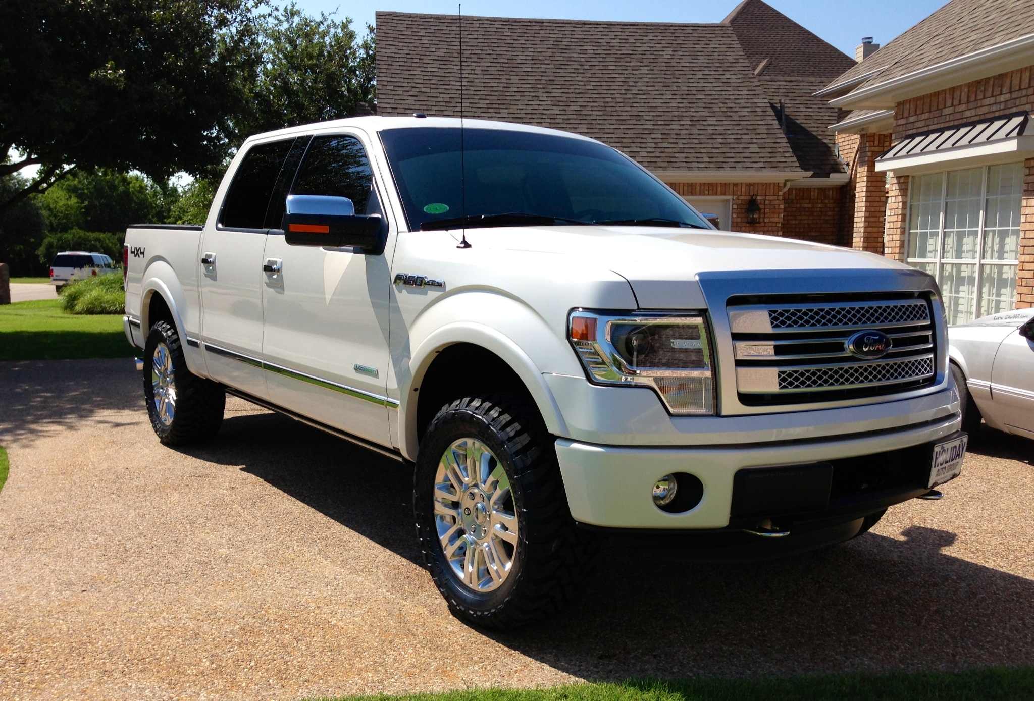 '13 Platinum 4x4 with Rancho Quick Lift & 33x12.5x20 Toyo Open Country MT's