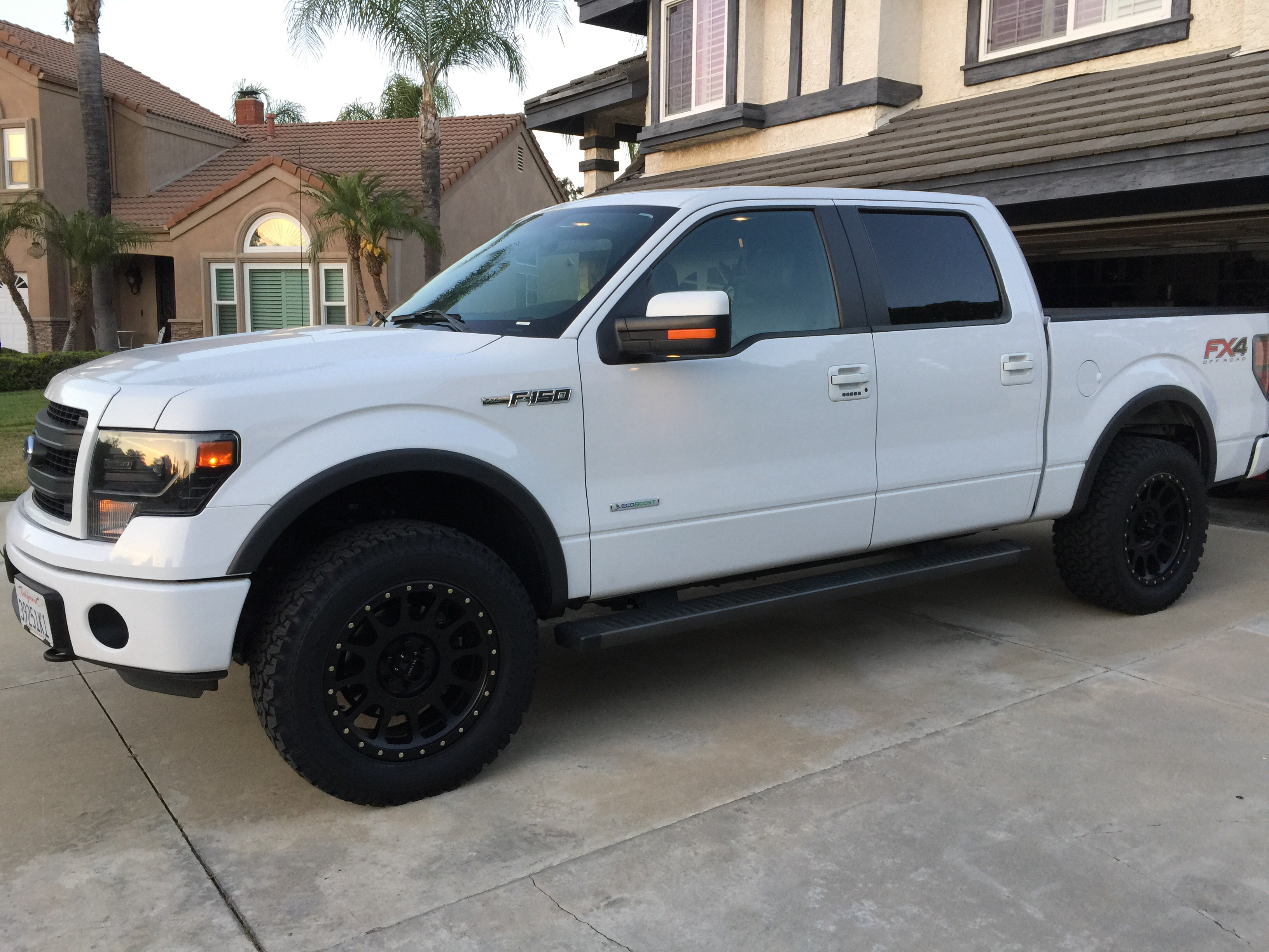 "What size tire for 14' 4x4 boost with 2.5"" leveling kit and 20x12 rims?"