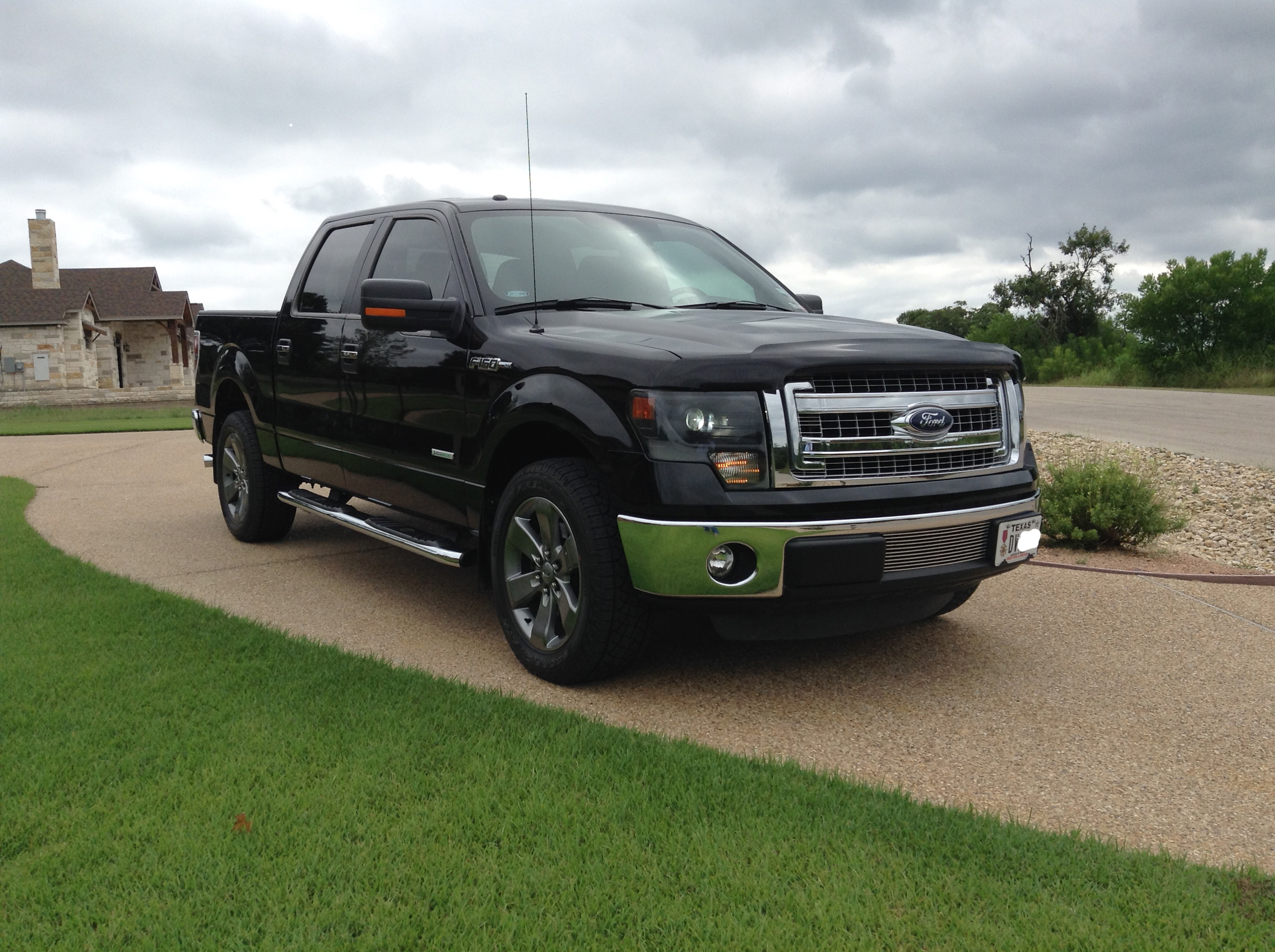 My 2013 XLT with FX4 4x4 wheels and OEM HID D1S upgrade
