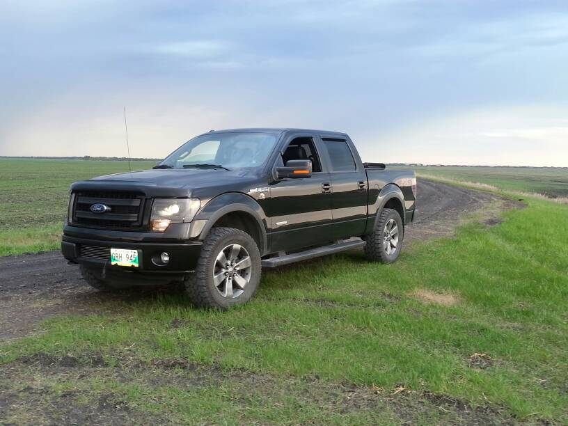 """2011 F150 Leveling Kit >> Pics of stock FX4 20"""" wheels with 35/12.5/20 tires?"""